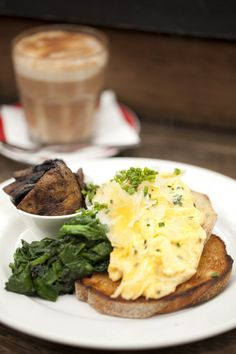 free range scrambled eggs w/ chives, shaved parmesan, truffle oil, mushrooms & sautéed spinach on sourdough toast - at Mart 130, Middle Park in Melb :)