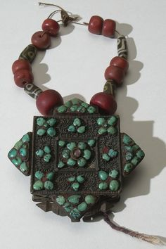 Tibet amulet. Silver and turquoise. Acquired by AMNH, 1937