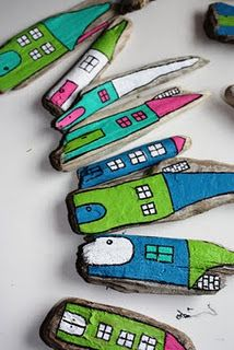 love these driftwood houses