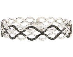 14k white gold black and white diamond bracelet.