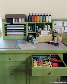Martha Stewart Craft Room. Love the sliding thin metal shelves on the left. And the linseed covering on the desk. (Martha via Everything Etsy.)
