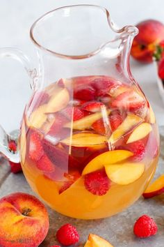 This easy Peach Sangria is ready in minutes! Fruity, refreshing and delicious - this will be your favorite summer cocktail. #sangria #peaches #peach #wine #cocktail