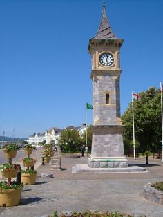 Diamond Jubilee Memorial Clock Tower, Exmouth. Built in 1897 for Victoria's diamond  jubilee. Behind, buildings on the seafront Esplanade.