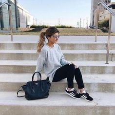 comfy saturday outfit, oversized grey sweater distressed black jeans, adidas black gazelle sneakers, laid back pony tail