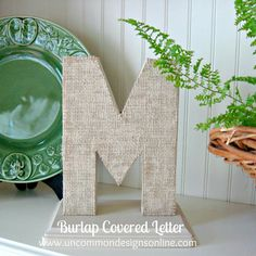 Burlap covered craft store or jig-sawed letters.  Blog: Uncommon Designs via- The Cottage Market