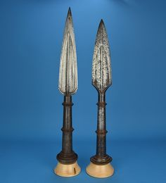 """Indian (south) heavy spear / lance heads (sang), one marked with numeric armoury marking in the South Indian dialect 'Kannada' """"3 79″ (the same language used in the Mysore armoury). 17th or 18th century or earlier, both are much bigger and heavier then most Indian spear heads seen, with leaf shaped blades, thick central spines, and swollen tips – made for real use. Faux Damascus pattern etched on the larger spear."""
