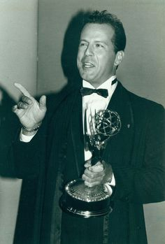 "Actor Bruce Willis, whose lengthy career began in television, hosted the Emmys the same year he won this award. A 1987 file photo shows Willis, winner of lead actor in a drama series for his work in the detective series ""Moonlighting,"" backstage. Lucky Number Slevin, Color Of Night, Detective Series, Thats All Folks, Favorite Movie Quotes, The Emmys, The Allure, The Expendables, Bruce Willis"