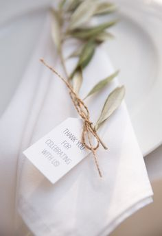 the perfect touch to a place setting ...sprig of rosemary or olive branch...thin twine...message?  (SH)  ----- I think this is perfect. We probably won't be able to afford gifts for people, so this would be a good touch. ----- (TH)