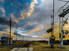 Sunset Along the Tracks on Rosedale Hwy by Wayne Wong on Capture Kern County // I love the sky when the clouds clear after a storm, especially at sunset.   Looking down the tracks at a RR crossing is a classic shot...