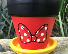 by FlourishAndPots Minnie Mouse bow hand painted flower pot. Browse unique items from FlourishAndPots on Etsy, a global marketplace of handmade, vintage and creative goods. Flower Pot Art, Clay Flower Pots, Flower Pot Crafts, Clay Pot Crafts, Clay Pots, Painted Plant Pots, Painted Flower Pots, Disney Garden, Mouse Paint