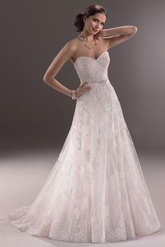 "I love designer Maggie Sottero AND I love this ""ethereal"" gown"