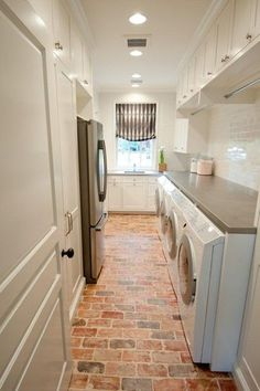Laundry room inspiration: combination of laundry and butler's pantry with a 2nd refregirator. Perfect for the lower level room.