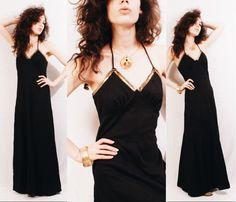 Vtg 70s Black Sequin Disco Halter Maxi Dress / Evening Gown by MoveBabyVintage on Etsy https://www.etsy.com/listing/268399990/vtg-70s-black-sequin-disco-halter-maxi