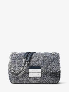 Our Sloan shoulder bag combines timeless tweed with a chain-trimmed shoulder strap to form one haute handbag. Tempered by modern hardware and a compact silhouette, this chic style chameleon will transition from AM to PM with polish.