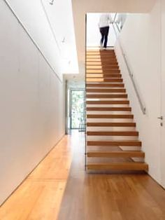 A ladder such as this one will surely transform the look of your hallway—not only because it looks weightless and effortless to climb, but also because it is the starting point to the second floor. You can reach new heights from this hallway!  Modern Corridor, hallway & stairs by HYLA Architects