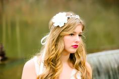 """Whimsy and charming flower hair crown. The popular """"song bird"""" hair clip now come on a crown with white berries. This crown is fully adjustable with white satin ribbon tie in back."""
