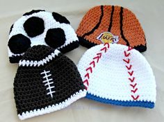 """Last Friday I mailed off this Sports Ball Pack I crocheted for a friend. She will be using them as a Baby Shower gift. The baseball hat has a touch of """"Chicago Cubs"""" blue, & the father-to-be is a huge Lakers fan, so I found an applique to add to the basketball hat."""