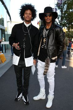 """Les Twins - """"Identical faces! Identical moves! There is not a doubt that French twin brothers Laurent and Larry Bourgeois of the hip-hop dancing duo Les Twins play up their likeness. The one thing that sets them apart? Their not-so-monozygotic styles. Their breakout fashion moment came at Anthony Vaccarello's Fall '15 show, where they sat on either side of Donatella Versace. Each had his own styling take on slouchy denim, layering, and cheeky sneakers. One twin even wore a fur stole over…"""