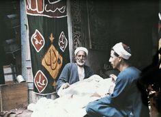 Two men make tents   Autochromes taken by Gervais Courtellemont and W. Robert Moore for National Geographic.  http://www.retronaut.co/2011/02/egypt-1920s-in-colour/#
