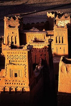 Aït Benhaddou in Morocco. Yes, people still live in there. Aït Benhaddou is a fortified city, or ksar, along the former caravan route between the Sahara and Marrakech in present-day Morocco.