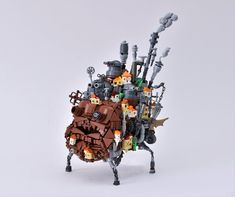 First Order Lego ( has built an amazing LEGO model of Howl's moving castle, with all the bells and whistles. Miyazaki, Lego Studios, Lego Sculptures, Studio Ghibli Movies, All Lego, Castle In The Sky, Weird Shapes, Lego Worlds, Bad Person