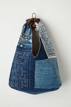 I love the blue materials used here with these patterns. It all seems to mesh so well. What I really like is the small leather hold on the bag.