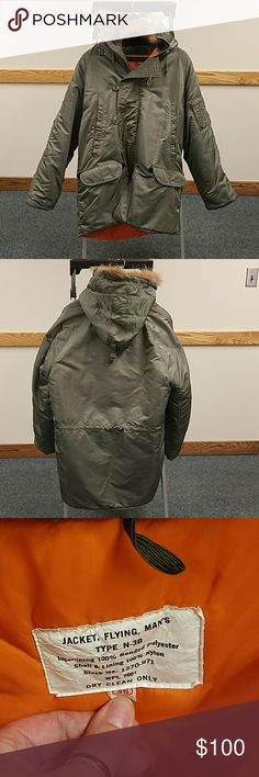 Vintage military parka Men's Flying jacket Vintage military jacket flying type n-3b Golden Fleece snorkel parka men's  46. There are 2 hip snap pockets w/leather arrowhead reinforce corners, 2 hand warmer pockets  w/double snap closure,  left utility pocket w/ zipper, reinforced elbow patching, rib knit cuffs hidden in the sleeves & an interior leather bolted drawstring at the waist for a secure fit. Shoulders 25 across, armpit to armpit 27 inches, 31 inches long.  No stains or holes fur has…