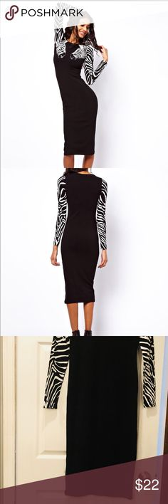 Black and white ASOS dress Black and white ASOS bodycon dress with zebra on sleeves. Worn once to dinner. Great condition. ASOS Dresses Midi