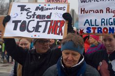 """The Women's March in Morris the Saturday after the inauguration of Donald Trump as POTUS.  There unofficial headcount was 271, on a drizzly day in west central Minneosota. The marches were in really good spirits, though, as we marched from the Stevens County Courthouse down 4th to Atlantic Avenue (Morris's """"Main Street""""), down Atlantic to 8th, across Atlantic, and then back down the other side of Atlantic to 5th."""