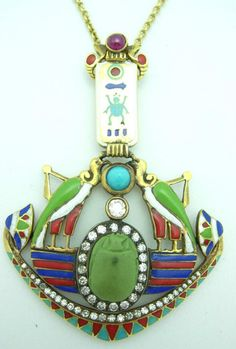 Egyptian Revival pendant with cartouche, vultures and winged scarab,gold and diamonds.