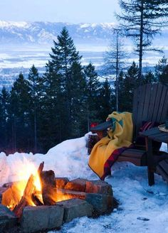 Imagine curling up in front of this amazing fire and watching the snow fall around you!