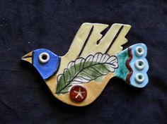 Handmade ceramic bird with an olive branch by RuhamaCohen
