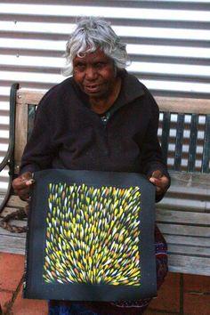 Gloria Petyarre with her artwork Medicine Leaves