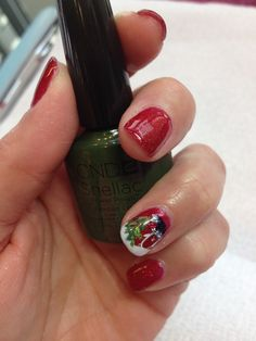 Shellac in Ruby Ritz with penguin stamp accent nail done in a variety of shellac colors by Kimberly Grove.