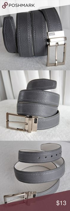 """Greg Norman Men's Pebbled Leather Reversible Belt Perfect on or off the course, this Greg Norman belt cut from a pebbled leather is finished with a gleaming square buckle with the iconic shark logo & White contrasting topstitching Features Metal single prong buckle 1.25"""" wide Leather Import - China Style #: 62258447/ 6961500 Greg Norman Accessories Belts"""