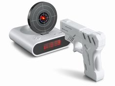Gun Alarm Clock. I would sleep all day if I didn't have to actually get OUT of bed to shut it off.  But.... I still need it.