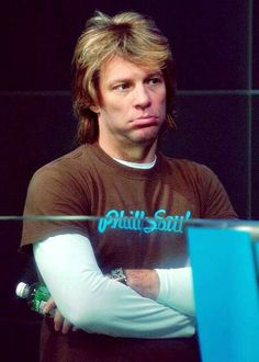 Jon Bon Jovi - at a Philadelphia Soul arena football game. I'm assuming they lost <cringe>. JBJ turned over ownership in 2011 to focus on purchasing an NFL team (still in progress).