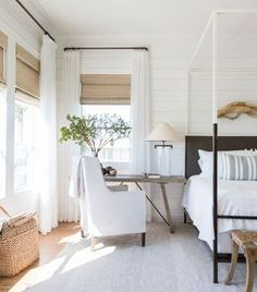 coastal bedroom decor with modern four poster bed with farmhouse bedding, farmhouse bedroom with shiplap and driftwood wall art, coastal master bedroom with woven shades, neutral airy bedroom decor with desk in bedroom, small home office in bedroom Home Decor Bedroom, Modern Bedroom, Bedroom Furniture, Bedroom Ideas, Contemporary Bedroom, Bedroom Designs, Furniture Decor, Trendy Bedroom, Diy Bedroom