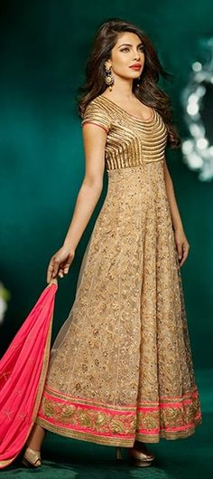 Priyanka Chopra in a golden salwar. Indian Bollywood fashion.