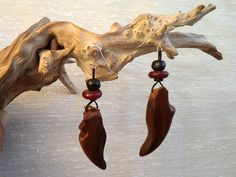 Small opposites. Olive wood earrings by ValleyWWKing on Etsy