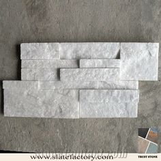 white quartzite ledger stone put in great room possible make this the fireplace surround in the shape of the french country surround. Nice sparkle!