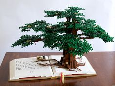 "LEGO tree on top of a journal --""Lego Tree of Knowledge: Reading Dreams"" by McBricker"