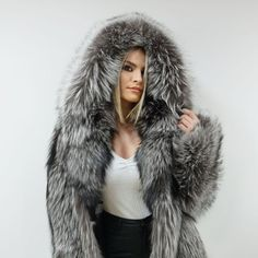 A luxury silver color fox fur jacket with hood. An elegant and trendy fur jacket that can be worn from day-to-night, on every occasion. This jacket has a luxurious aesthetic that will make you stand out for your style. Made from high-quality Scandinavian fox skins in our company in Greece! Hooded Bomber Jacket, Fox Fur Jacket, Fox Fur Coat, Luxury Gifts For Her, Grey Fox, Jacket Brands, White Fur, Fur Collars, Elegant