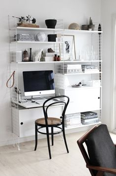 Home office with String shelving 7 desk in Johanne's lovely Aalborg apartment in monochrome