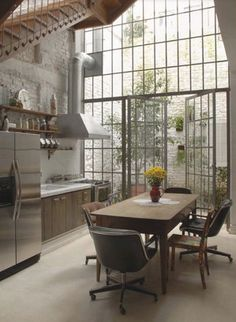 Loft living - LOVE this wall of windows!