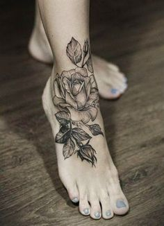 Using Grey ink for flower tattoos is getting popular now. See Here is a gallery in this article  where mostly tattoos fo flower using grey and black white ink. Here using black grey ink for design a rose tattoo on foot.