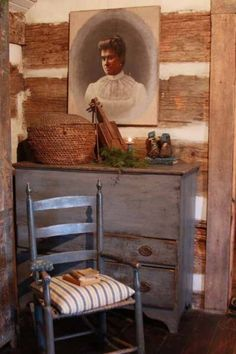 Log wall with old wood chest and chair - Nice.