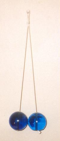 Clackers, my Uncle Garth made mine..they were so much fun, but really bruised your arms when you missed!