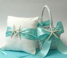 ring bearer pillow and flower girl basket is a beautiful beach theme.