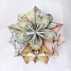 Kusudama Origami Ball Tutorial.  Starts with the pin about how to make a single flower.  :)